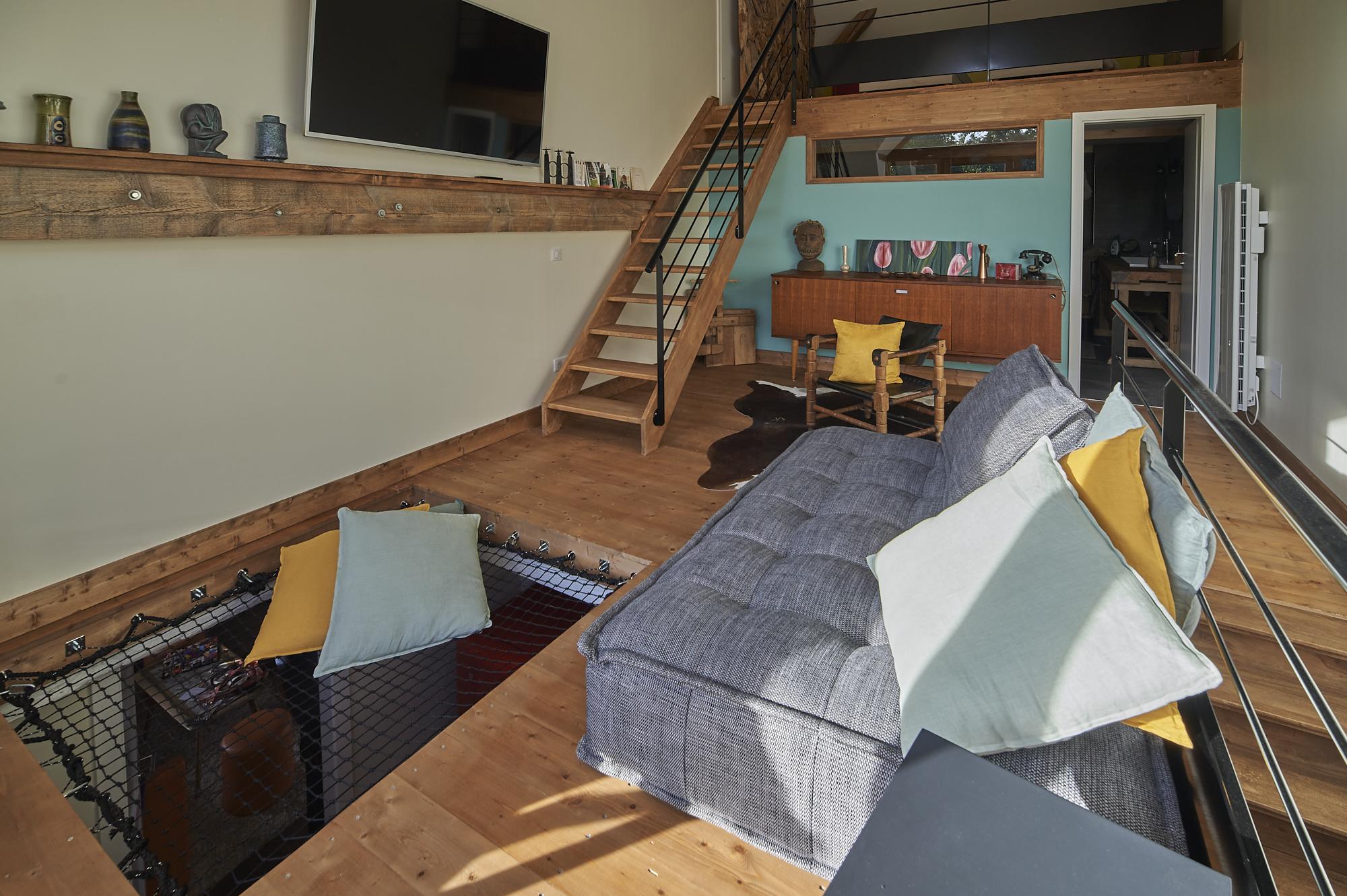 Grand salon avec futon dans le gite familliale proche de Strasbourg